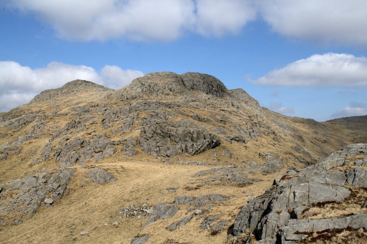 Looking up Esk Pike's south ridge from Yeastyrigg Crags. The pointed top on the left is Pike de Bield