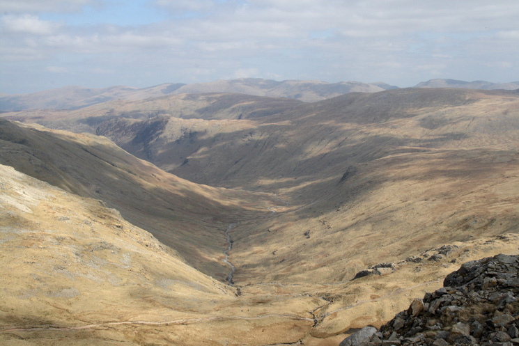 The top of Langstrath from Esk Pike with the Helvellyn ridge on the skyline