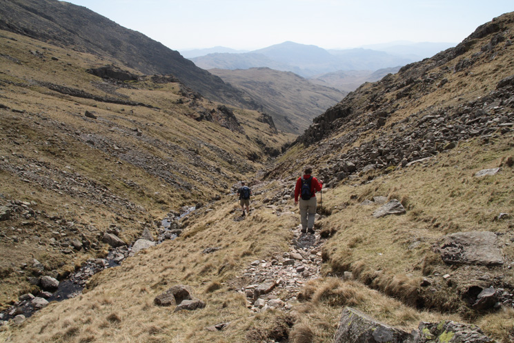 Starting our descent to Great Moss and Eskdale from Esk Hause. The pointed peak in the distance is Harter Fell