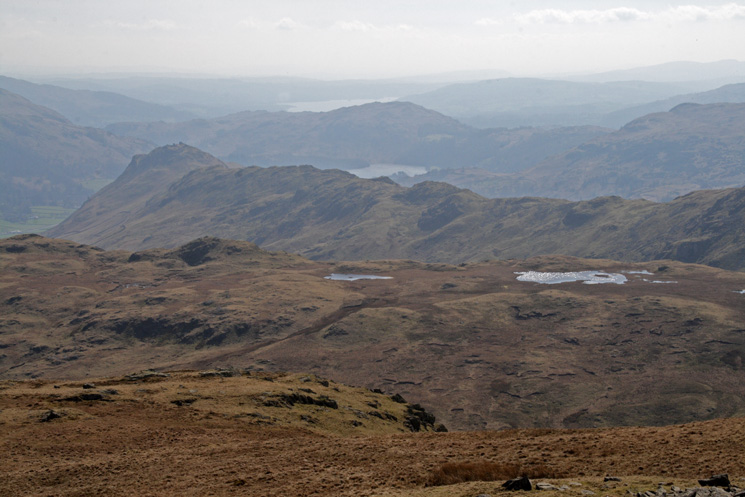 The view south over the Steel Fell tarns to Helm Crag, Grasmere, Loughrigg Fell and Windermere
