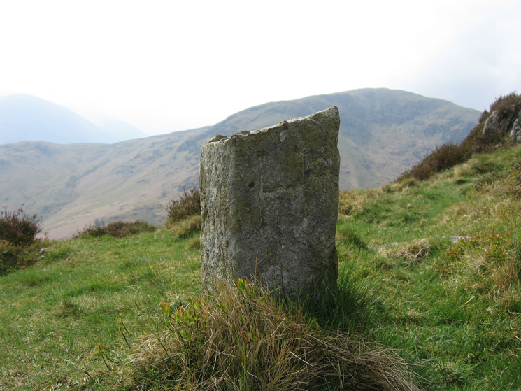 A boundary stone on the way up Sheffield Pike's south-east ridge - 'H' for the Howard estate of Greystoke