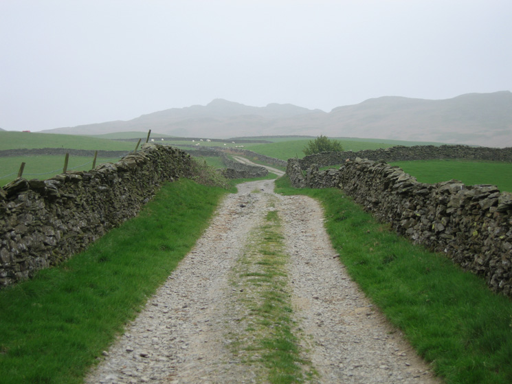 Whiteside Pike ahead on the skyline as we head for the open fell along this walled track through the farmland