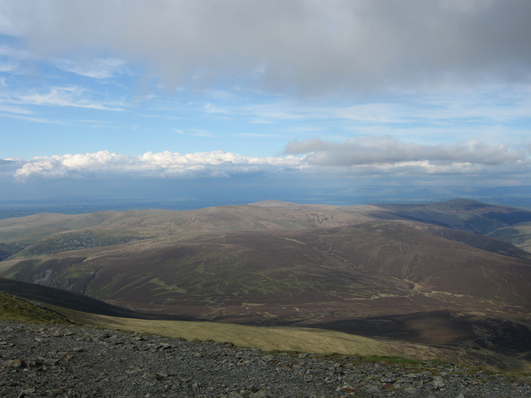 The northern fells with Knott the highest (centre shot) and Carrock Fell on the far right from Skiddaw's summit