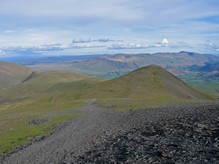 Lonscale Fell and Skiddaw Little Man with the Helvellyn range in the distance from Skiddaw