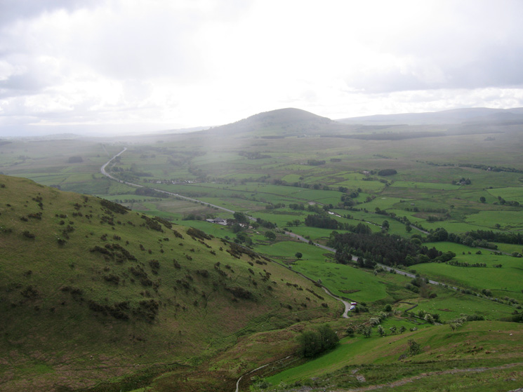 Great Mell Fell from above Mousthwaite Comb as a rain shower passes through