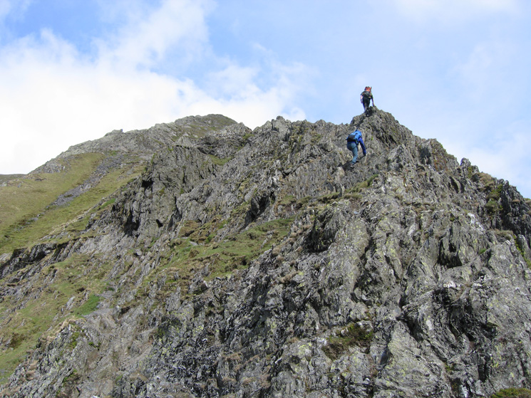 Walkers heading up Hall's Fell Ridge