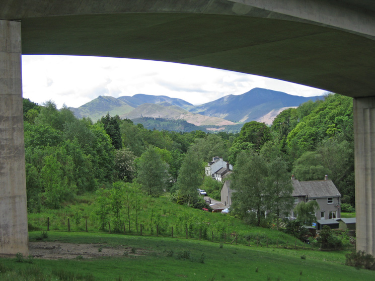 The north western fells seen through an arch of the A66 Greta road bridge (Keswick bypass)
