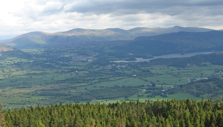 Keswick and Derwent Water with the Helvellyn ridge beyond from Seat How