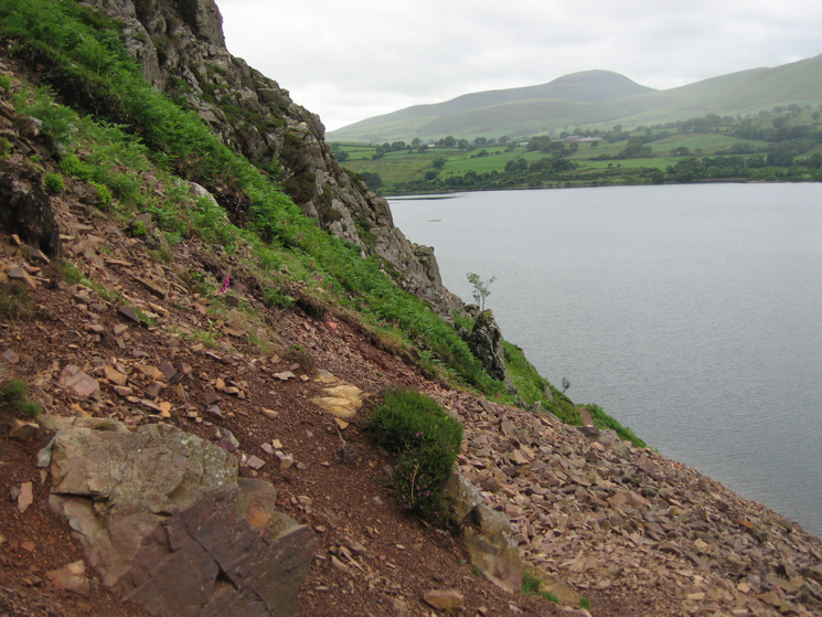 On the path under Anglers' Crag with Knock Murton in the distance