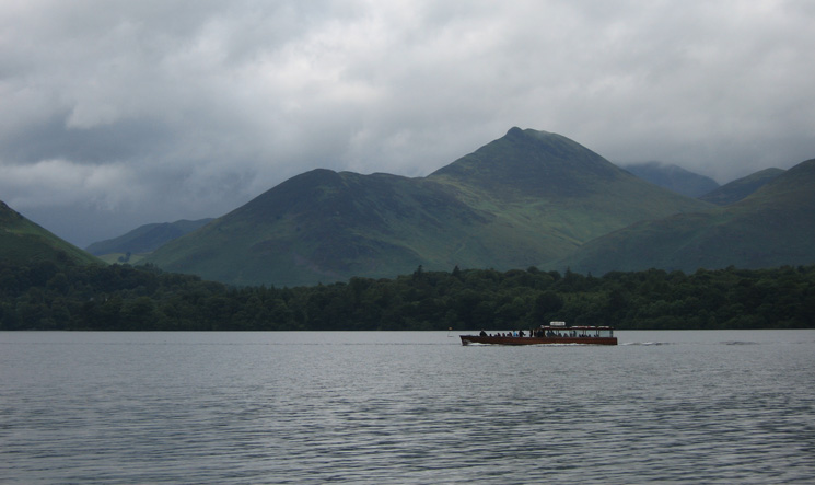 A Derwent Water launch passes in front of Causey Pike