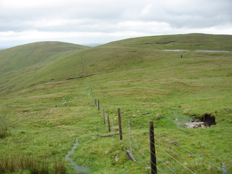 Looking back to Selside Pike (left) and High Howes (behind the tarns and survey post on the right)