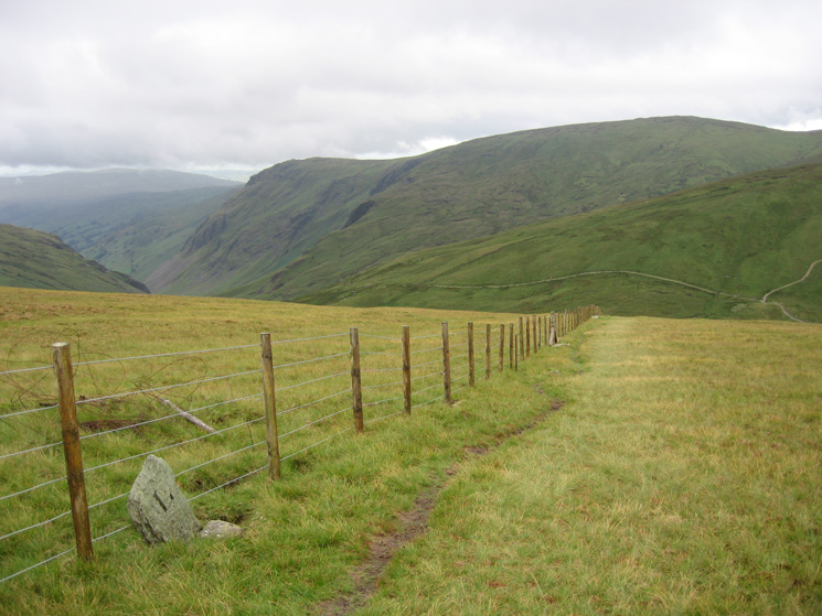 The fence down to Gatescarth Pass from Branstree's summit, Longsleddale, Goat Scar and Kentmere Pike