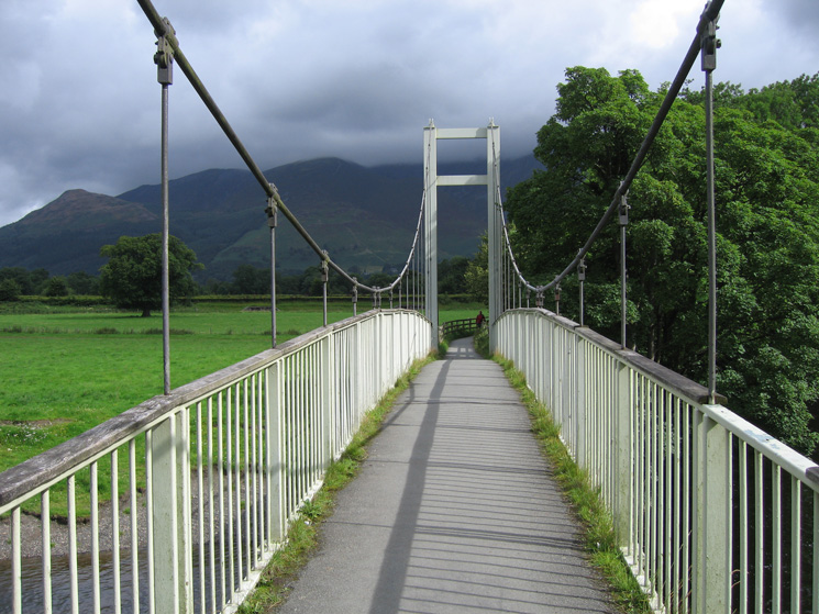 The Skiddaw fells in cloud from the Portinscale suspension bridge over the River Derwent