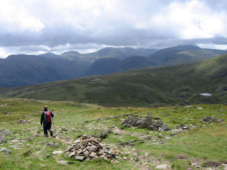 Heading down to Dalehead Tarn (far right) with the high central fells ahead