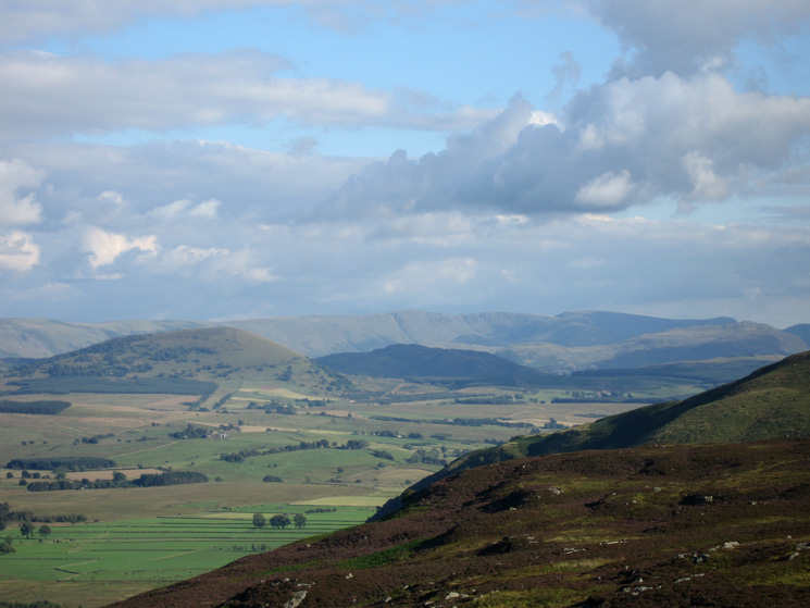 Great Mell Fell, Gowbarrow Fell (in shadow) with the High Street Fells beyond