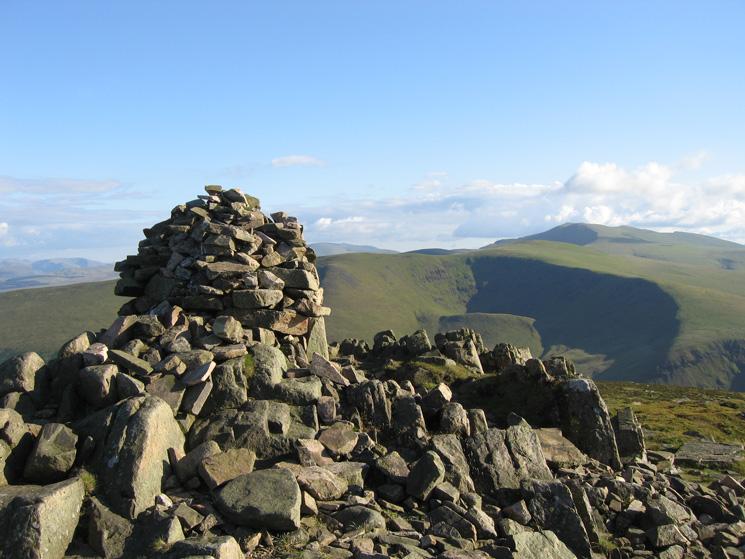 Carrock Fell's summit cairn with Blencathra behind Bowscale Fell