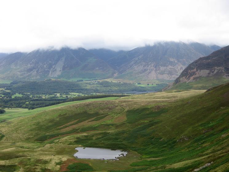 Whiteside and Grasmoor both with their tops in cloud and Highnook Tarn below