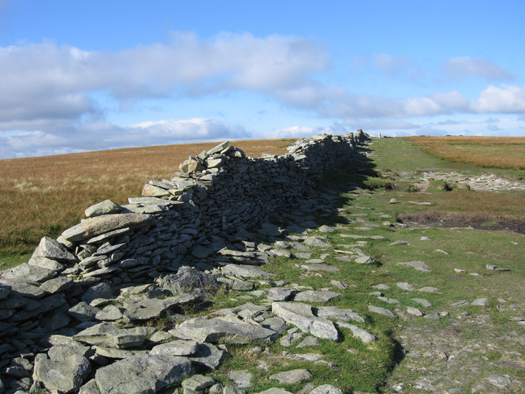 The wall across the top of High Street with the white summit trig point on the skyline