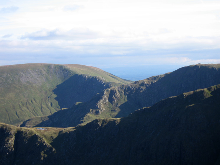 Zooming in on Mardale Ill Bell's north ridge with Long Stile in front and Harter Fell behind left