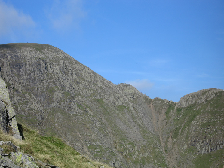 Looking across Nethermost Cove to the end of Striding Edge and the climb to Helvellyn's summit