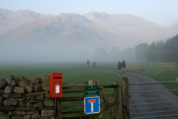 Misty in the valley. The road to Stool End Farm with The Band leading onto Bowfell ahead