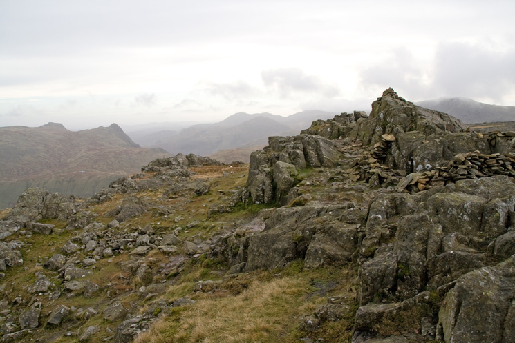 Glaramara's summit with the Langdale Pikes in the distance on the left