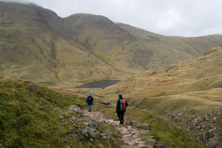 The path to Sty Head with Styhead Tarn below and Green Gable now completely out of the cloud