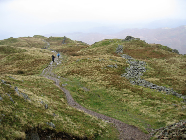 The cairn on the right marks Nab Scar's summit per Wainwright. As the path does not visit it most people miss it!