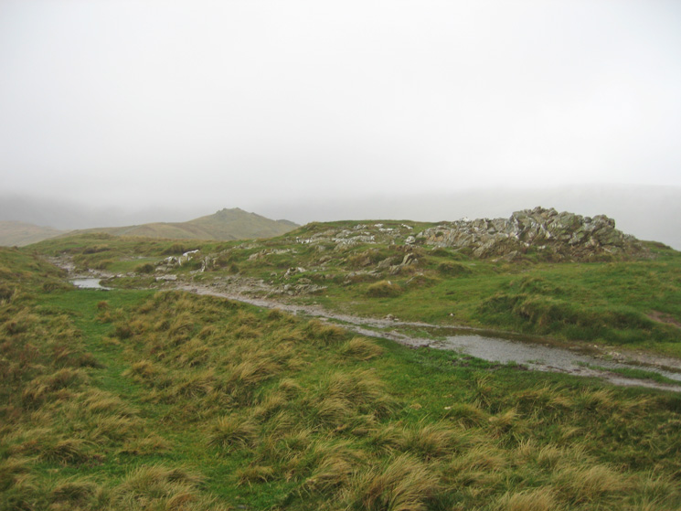 This white quartz marks Heron Pike's summit. The further summit is Erne Crag top and is actually 9m higher