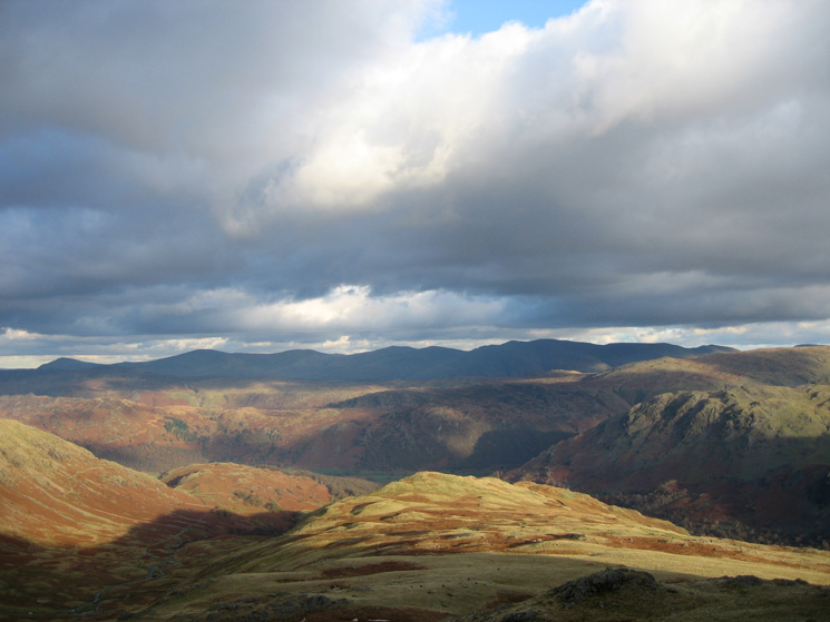 The view east to the Helvellyn ridge as we head down to Honister Pass