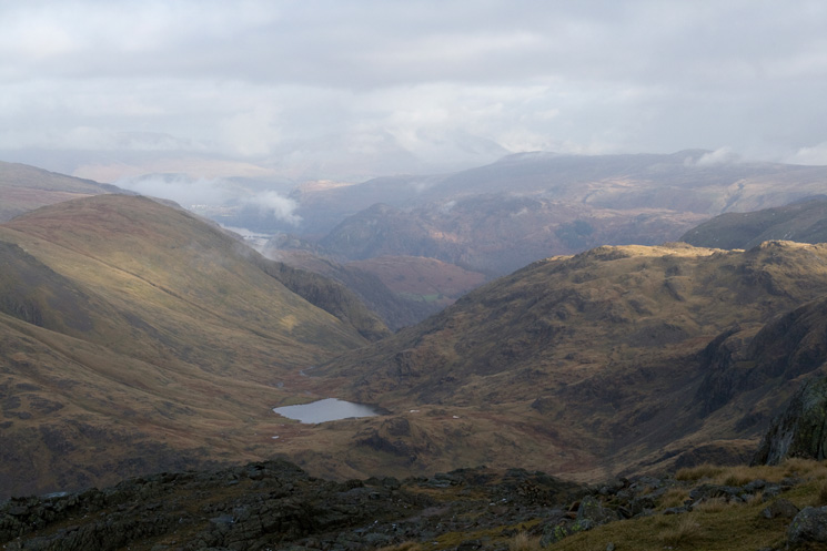 Styhead Tarn and the view north from the ascent of Scafell Pike from Lingmell Col