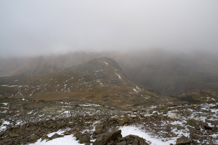 Looking down on Lingmell as we head into the clouds