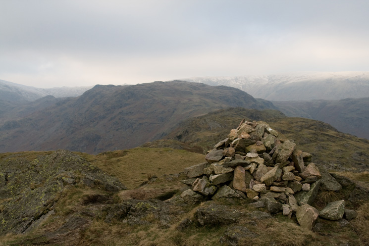 Looking ahead to Pike of Carrs with Calf Crag's summit on the far left, from Gibson Knott's summit