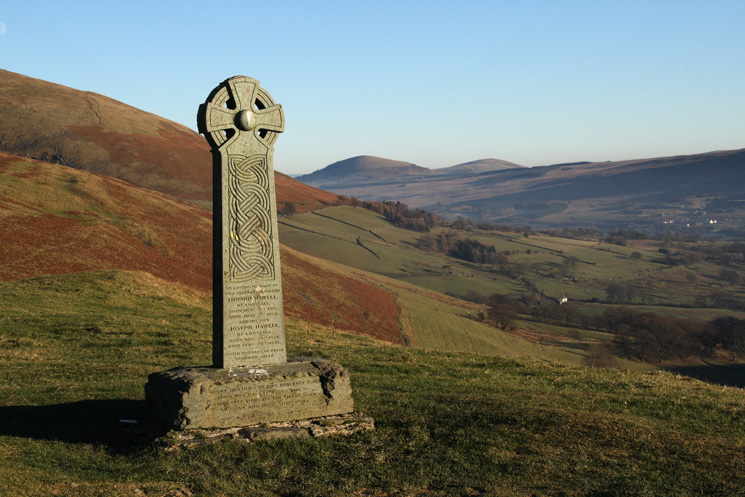 The Hawell Monument with Great Mell Fell and Little Mell Fell in the distance