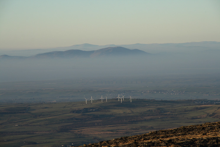 The Wharrels Hill wind turbines near Bothel with Criffel behind sticking out above the haze