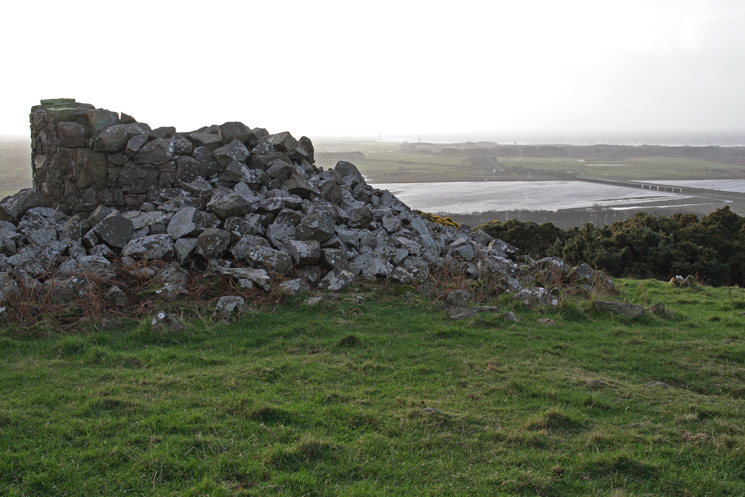 The remains of the beacon on Newtown Knott with Eskmeals Viaduct on the right