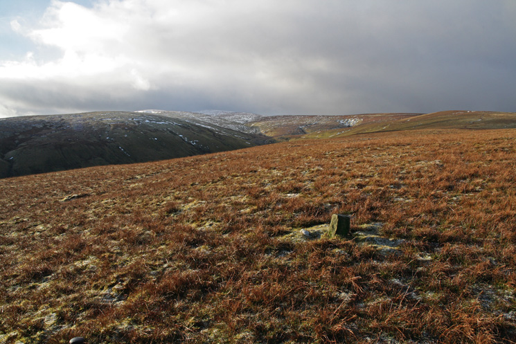 Red Crag at the head of the valley with a snow covered High Raise just visible on the left from Low Kop