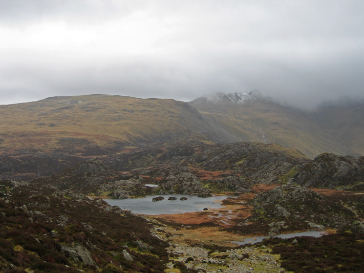 Innominate Tarn with Brandreth out of the cloud but the top of Green Gable in cloud