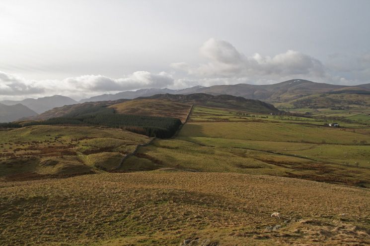 Looking back along the ridge to Gowbarrow Fell with the Dodds behind
