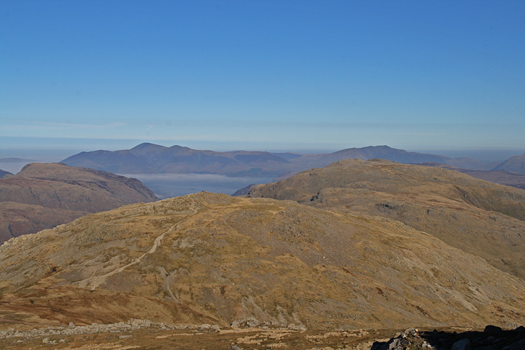 The Allen Crags to Glaramara ridge with Skiddaw and Blencathra in the distance