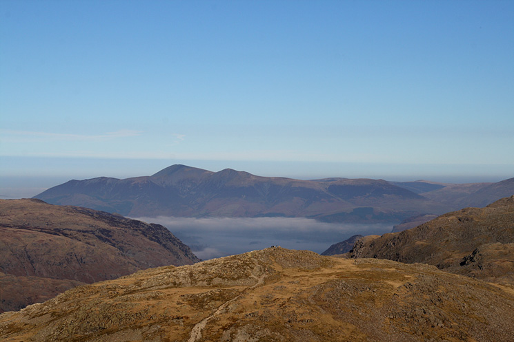 Skiddaw and a glimpse of Derwent Water seen over Allen Crags' summit