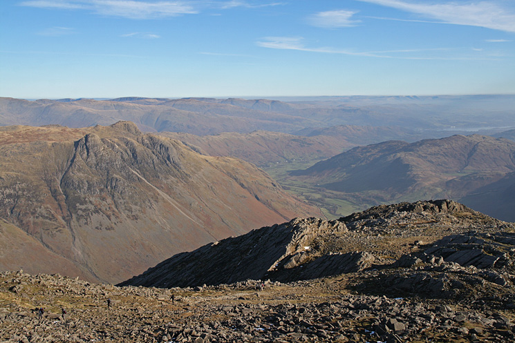 Looking over the top of Great Slab to the Langdale Pikes