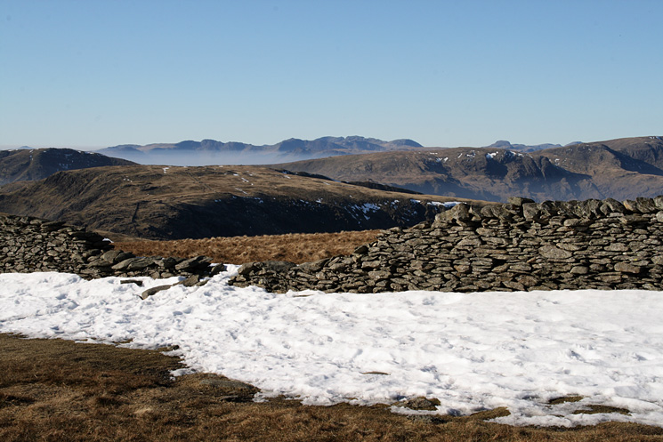 Looking over Caudale Moor to Crinkle Crags, Bowfell and the Scafells and with Great Gable behind Dove Crag from High Street