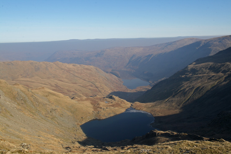 Small Water and Haweswater with Cross Fell and the Dun Fells sticking out above the haze on the far side of the Eden valley