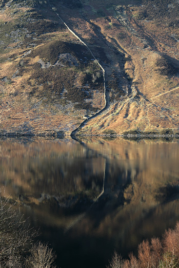 The wall coming down Crag Fell reflecting in Ennerdale Water