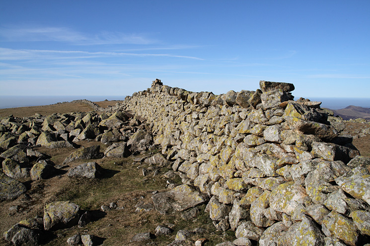 Scoat Fell's summit. The summit cairn is actually on the wall!