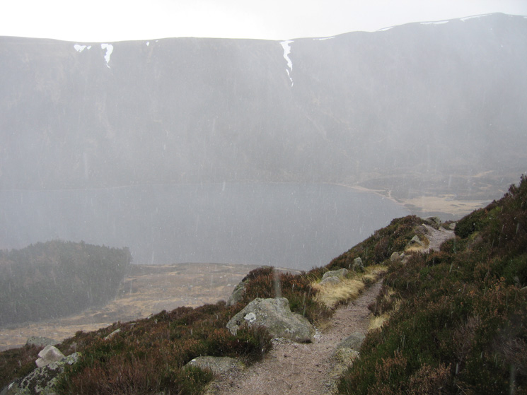 A snow shower as I descend to Loch Muick