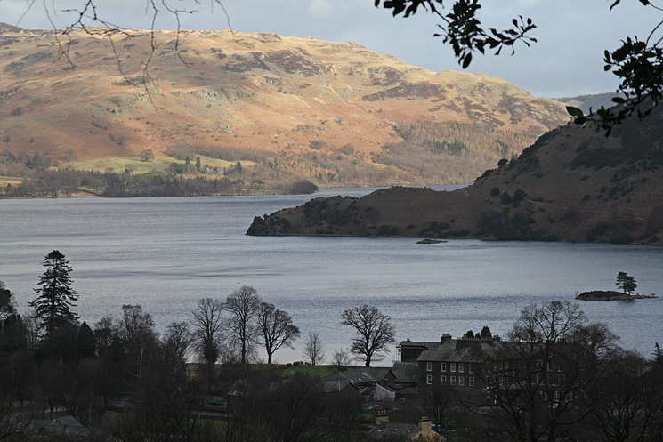 Silver Point sticking out into Ullswater with Gowbarrow Fell in sunshine beyond