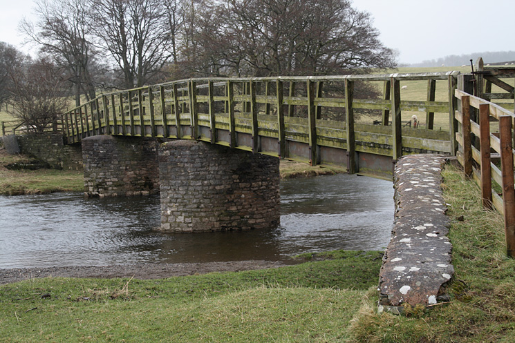The footbridge across the River Lowther between Helton and Whale