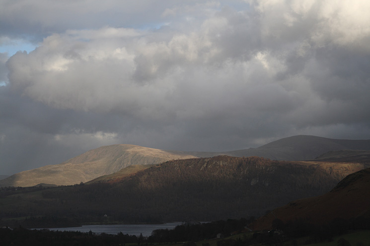 Sunshine on Walla Crag and a floodlit Clough Head behind